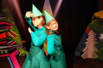 Two woman dressed as Christmas trees