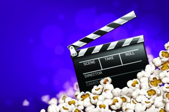 Clapperboard and popcorn on a purple background