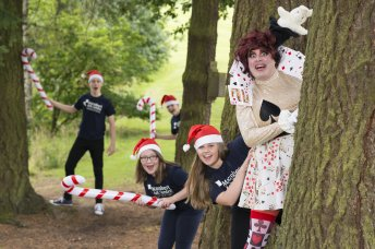 Panto dame hiding in woods with children
